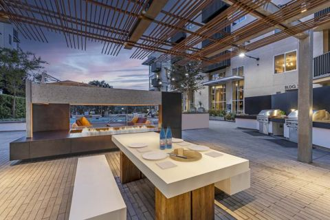 Outdoor Barbecue Grilling Area with Dining Table and Fireplace at Camden Glendale Apartments in Glendale, CA