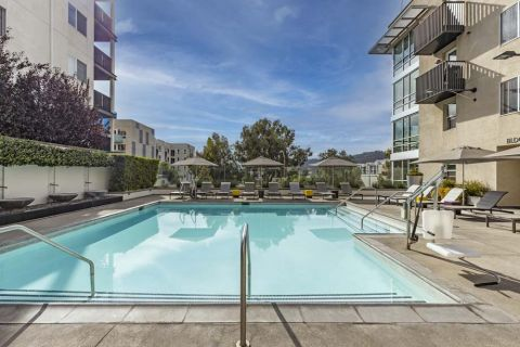 Resort-Style Pool with Seating and Lounge Areas at Camden Glendale Apartments in Glendale, CA