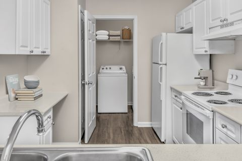 Kitchen and laundry room at Camden Governors Village Apartments in Chapel Hill, NC