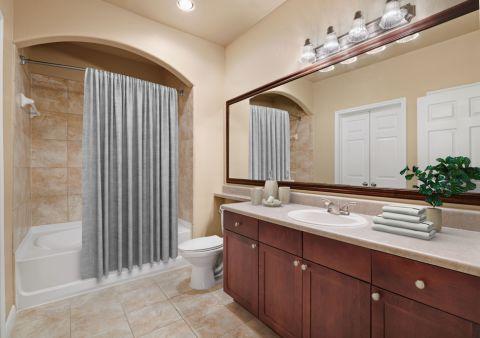Bathroom at Camden Grand Harbor Apartments in Katy, TX