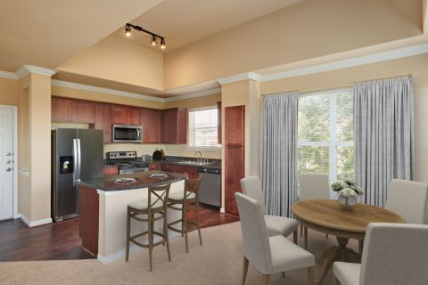 Kitchen and Dining Area with Vaulted Ceilings at Camden Grand Harbor Apartments in Katy, TX
