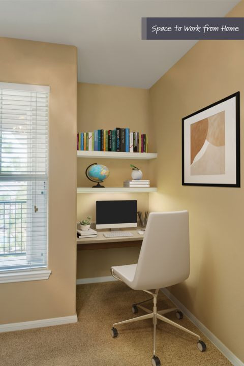 Bedroom with built-in desk for home office space at Camden Grand Harbor Apartments in Katy, TX