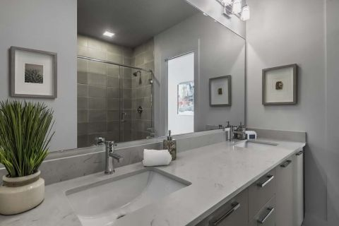 Bathroom with dual vanity at Camden Grandview Townhomes in Charlotte, NC
