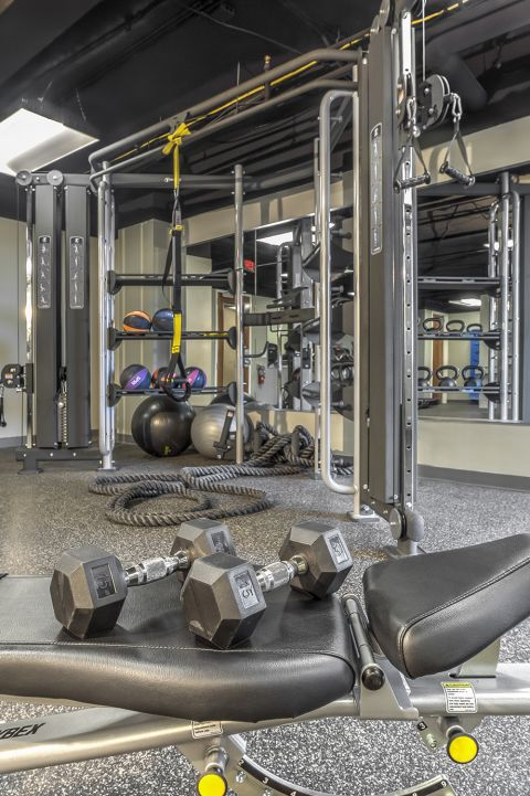 Fitness Center with Free Weights and Resistance Training Equipment Camden at Grandview Apartments in Charlotte, NC