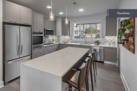 Kitchen with Stainless Steel Appliances at Camden Grandview Townhomes in Charlotte, NC