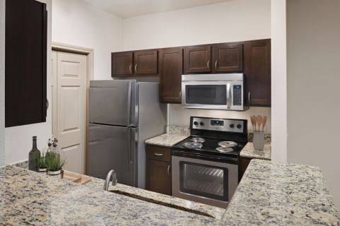 Kitchen with Stainless Steel Appliances at Camden Greenway Apartments in Houston, TX