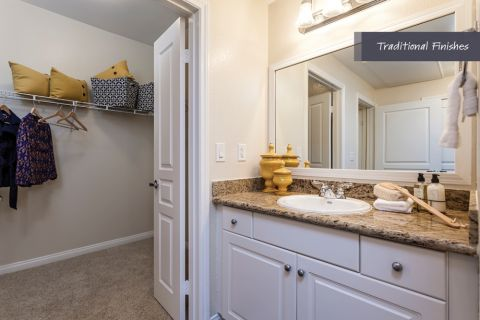 Bathroom with traditional finishes and walk-in closet at Camden Harbor View Apartments in Long Beach, CA