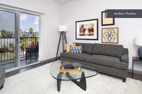 Living room and patio at Camden Harbor View Apartments in Long Beach, CA