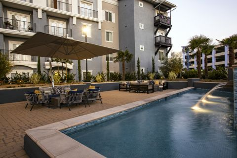Resident lounge with outdoor seating at Camden Harbor View Apartments in Long Beach, CA