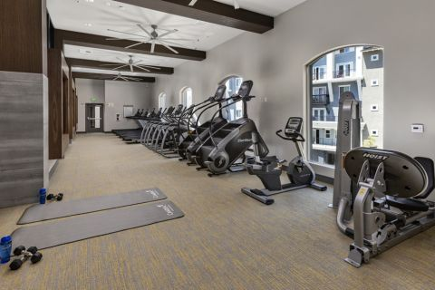 Fitness center with cardio equipment at Camden Harbor View Apartments in Long Beach, CA
