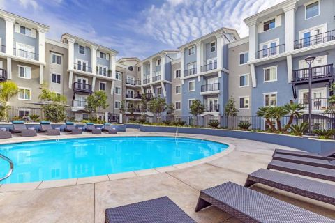 Pool with Lounge Chairs on Sun Deck at Camden Harbor View Apartments in Long Beach, CA