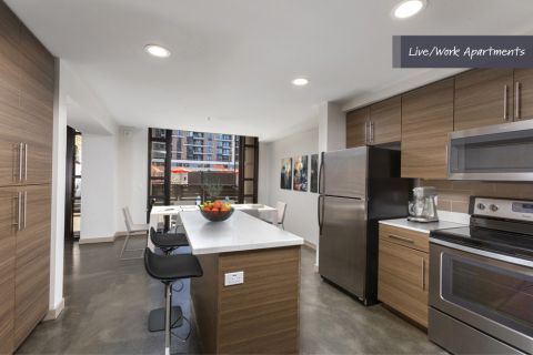 Kitchen with stainless steel appliances at Camden Harbor View Live/Work Apartments in Long Beach, CA