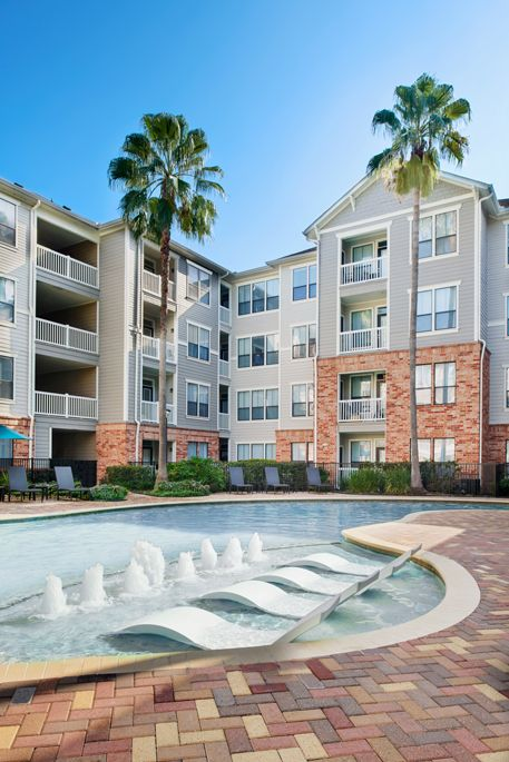 Resort-Style Swimming Pool with Lounge Chairs at Camden Heights Apartments in Houston, TX