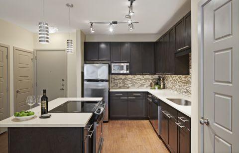 Kitchen at Camden Henderson Apartments in Dallas, TX