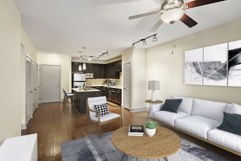 Living Room and Kitchen in Open-Concept Layout at Camden Henderson Apartments in Dallas, TX