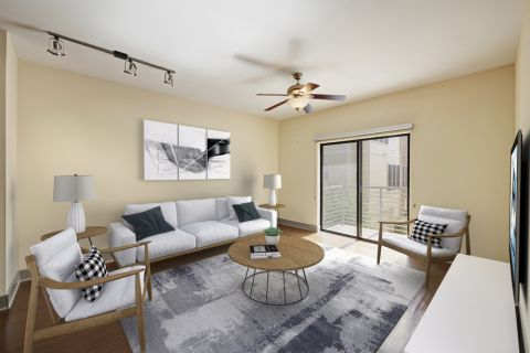 Spacious Living Room with Private Patio Access at Camden Henderson Apartments in Dallas, TX