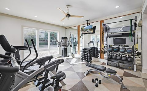 Fitness Center with Cardio Equipment at Camden Henderson Apartments in Dallas, TX
