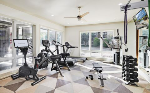 Fitness Center with Free Weights at Camden Henderson Apartments in Dallas, TX