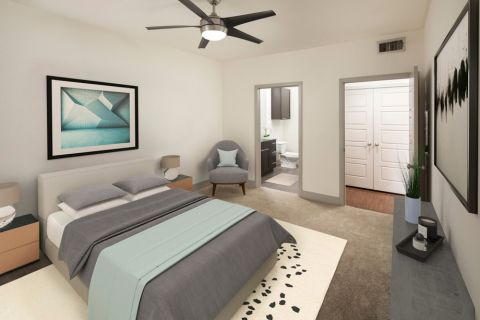Large bedroom with attached bathroom at Camden Henderson Apartments in Dallas, TX