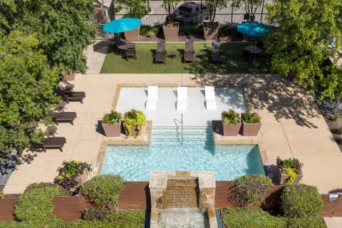 Swimming Pool with Lounge Chairs at Camden Henderson Apartments in Dallas, TX