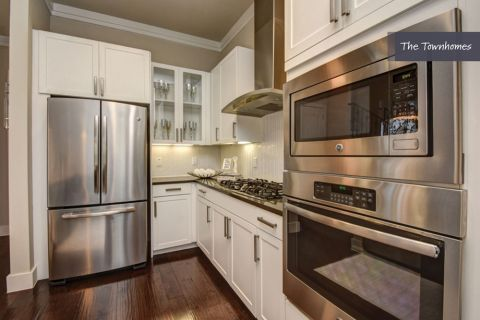 Kitchen with Stainless Steel Appliances at The Townhomes at Camden Highland Village in Houston, TX