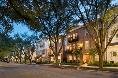 Townhome Exterior at dusk at Camden Highland Village in Houston, TX