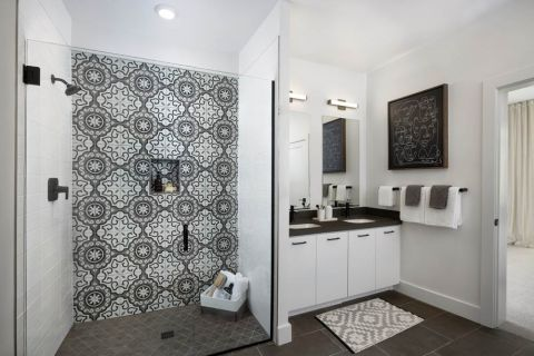 Bathroom with decorative tile and glass door to shower at Camden Hillcrest Apartments in San Diego, CA