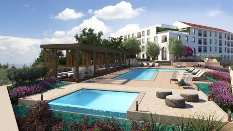Infinity pool with landscaped pool deck at Camden Hillcrest Apartments in San Diego, CA