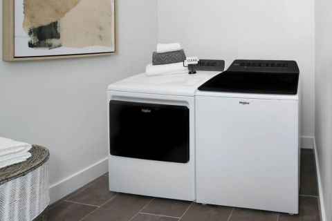 Laundry room with full-size washer and dryer at Camden Hillcrest Apartments in San Diego, CA