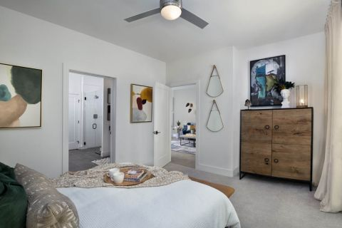 Bedroom with ensuite bath and ceiling fan at Camden Hillcrest Apartments in San Diego, CA