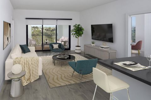 Open concept living and dining area with balcony and flex space at Camden Hillcrest Apartments in San Diego, CA