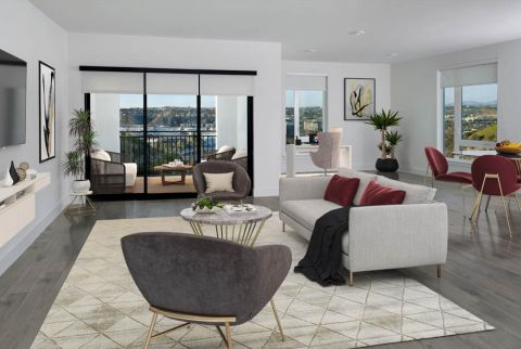 Open concept living and dining area with work from home space and balcony at Camden Hillcrest Apartments in San Diego, CA