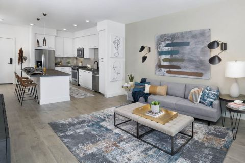 Open concept living area with wood-look flooring at Camden Hillcrest Apartments in San Diego, CA