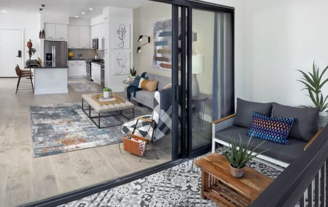 Patio with decorative tile and sliding glass doors into living room at Camden Hillcrest Apartments in San Diego, CA