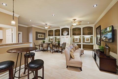 Social Lounge with Kitchen and TV at Camden Holly Springs Apartments in Houston, TX