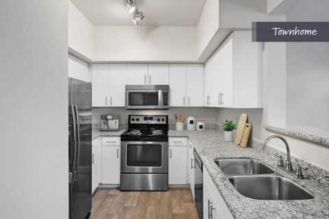 Townhome Kitchen at Camden Holly Springs Apartments in Houston, TX