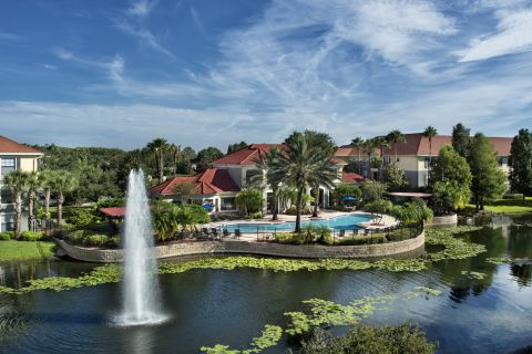 Lake at Camden Hunters Creek Apartments in Orlando, FL