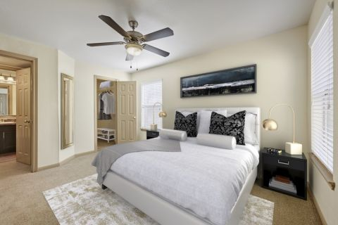Bedroom with Attached Bathroom and Walk-In Closet at Camden Huntingdon Apartments in Austin, TX