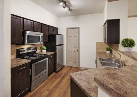 Kitchen with Stainless Steel Appliances at Camden Huntingdon Apartments in Austin, TX