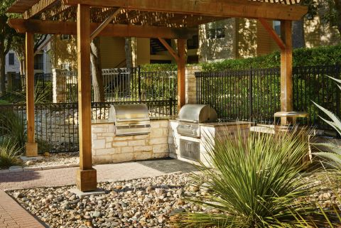 Outdoor Grill Areas at Camden Huntingdon Apartments in Austin, TX