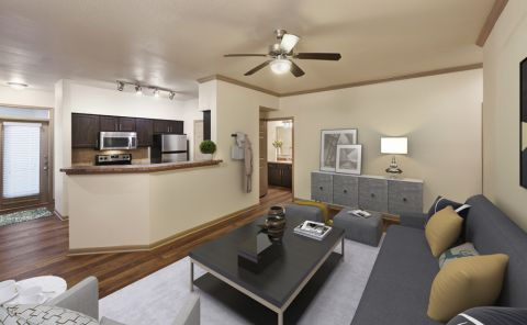 Living Room and Kitchen at Camden Huntingdon Apartments in Austin, TX