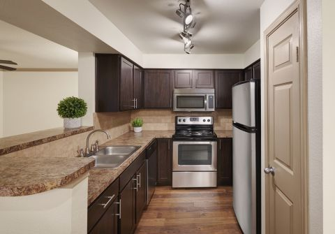 Galley Kitchen with Stainless Steel Appliances at Camden Huntingdon Apartments in Austin, TX