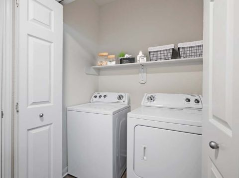 Full-Size Washer and Dryer in Laundry Room at Camden Huntingdon Apartments in Austin, TX
