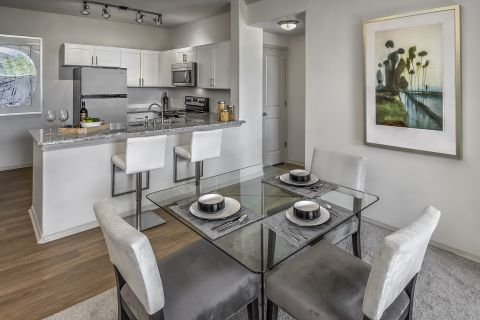 Open Concept Kitchen and Dining at Camden Interlocken Apartments in Broomfield, CO