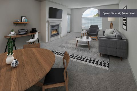 Living room with home office space at Camden Interlocken Apartments in Broomfield, CO