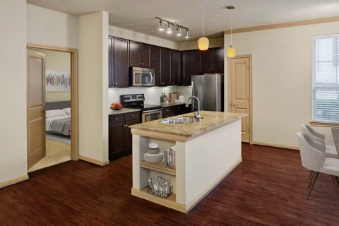 Kitchen with island at Camden La Frontera Apartments in Round Rock, TX