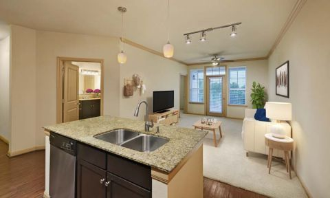 Kitchen with island at Camden La Frontera Apartments in Round Rock,TX