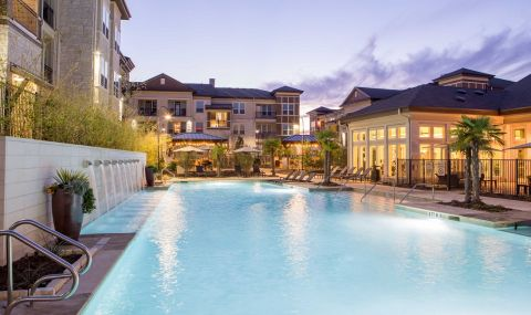 Pool with Water Feature at Night, Camden La Frontera Apartments in Round Rock, TX