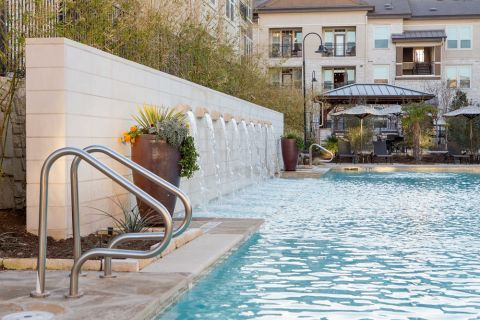 Water Feature in Pool at Camden La Frontera Apartments in Round Rock, TX
