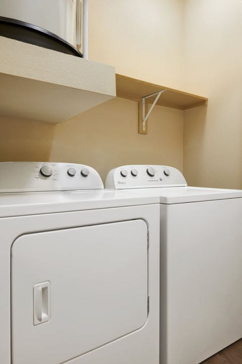Full-size washer and dryer at Camden La Frontera Apartments in Round Rock, TX